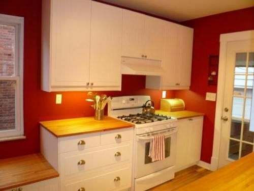 Love the white cabinets and butcher block counter tops. Do not like ...