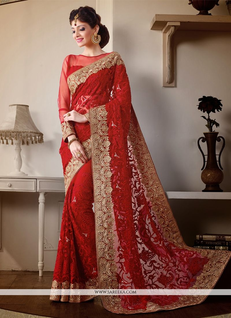 e3226b62b0 Beautiful red net wedding saree lining designed with embroidery, resham,  zari, bead, lace and patch border work. Available with matching art silk  blouse.