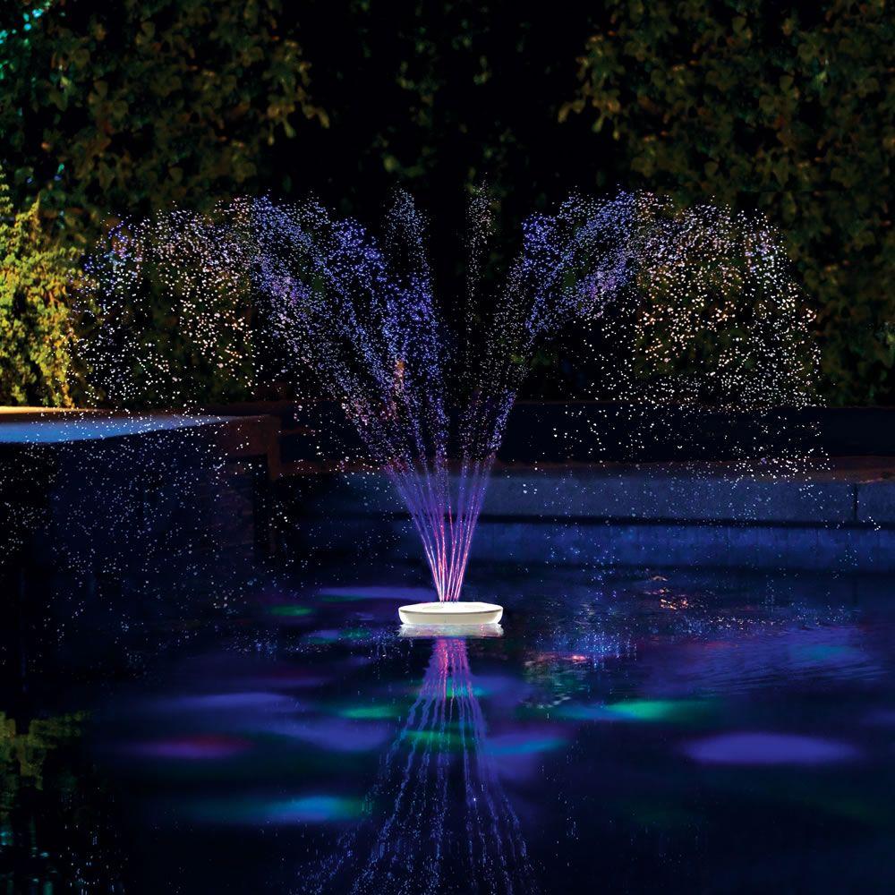 Floating pool lights on pinterest solar pool lights backyard pool - The Floating Lighted Pool Fountain Hammacher Schlemmer