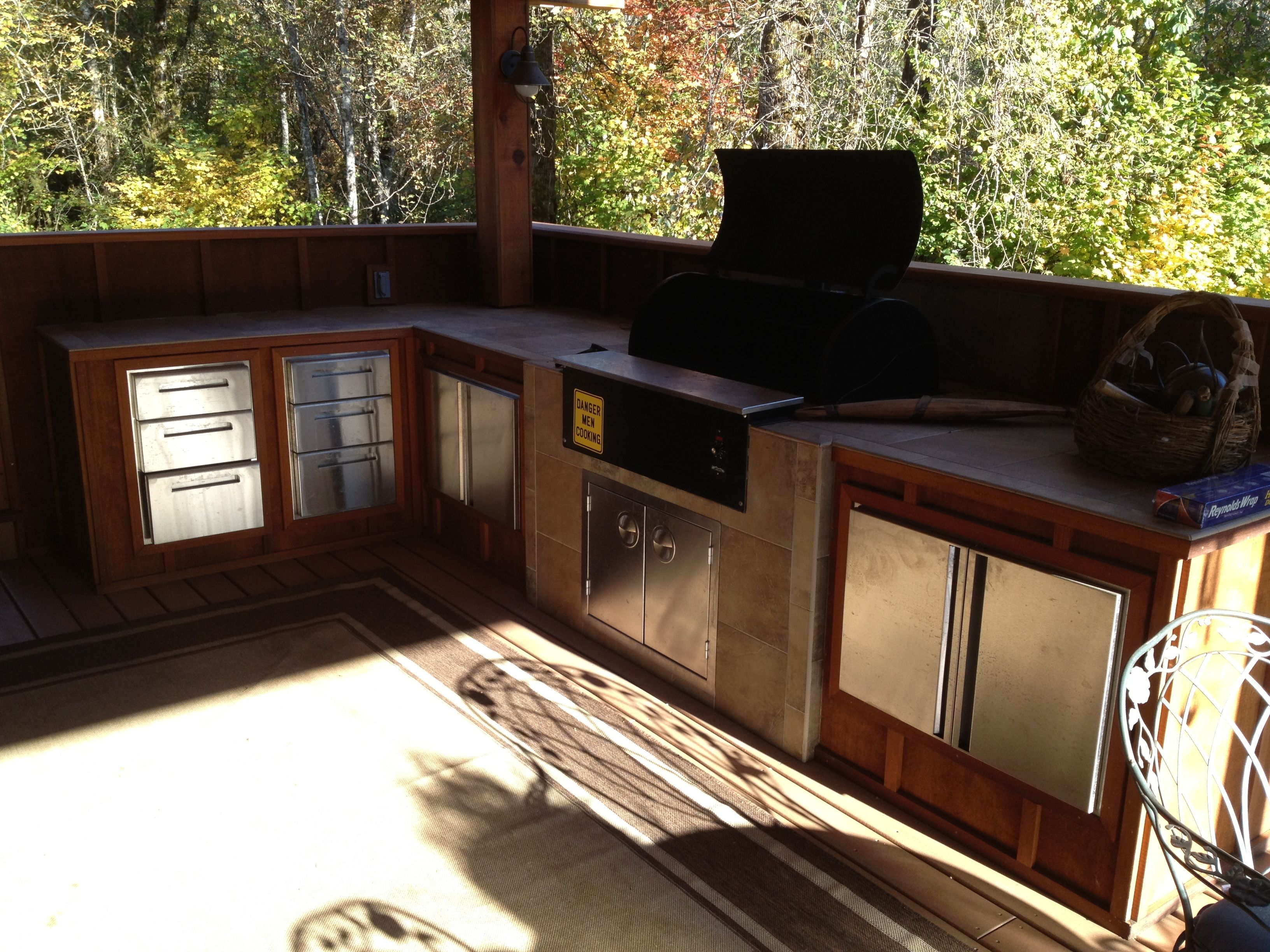 Outdoor kitchen with built in traeger outdoor living for Built in outdoor grill plans