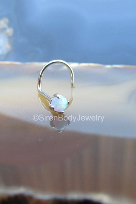 Featuring a creamy 25mm white opal this solid 14k gold nose ring