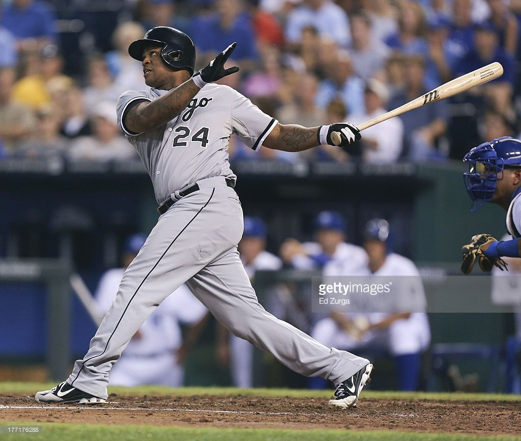 Dayan Viciedo #24 of the Chicago White Sox hits a grand slam in the fourth inning against the Kansas City Royals at Kauffman Stadium August 21, 2013 in Kansas City, Missouri.