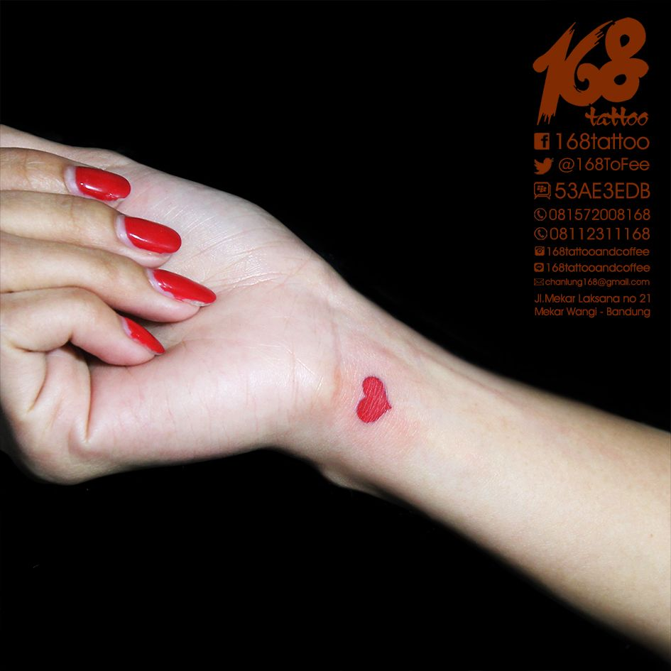 simple heart tattoo on wrist Red heart tattoos, Heart