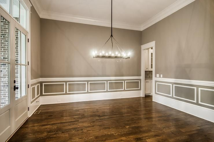 amazing dining room features walls painted gray accented with white wainscoting and chair rail. Black Bedroom Furniture Sets. Home Design Ideas