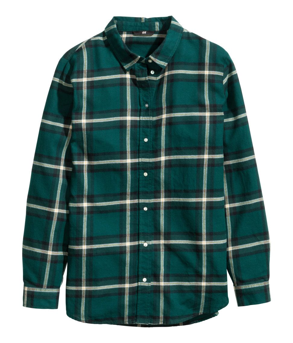 e0a6b501579 Dark green plaid flannel shirt with pearlescent buttons.