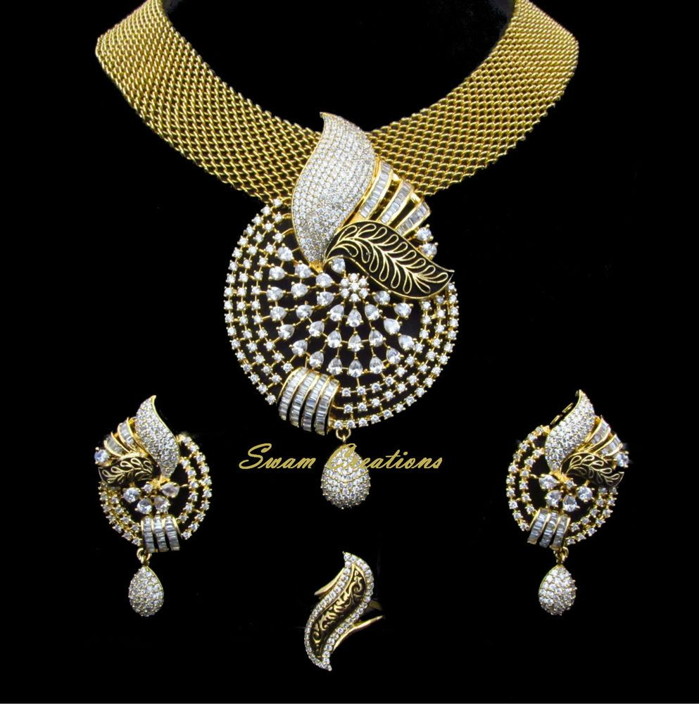 Indian bridal cz ad golden colored antique bollywood pendant set
