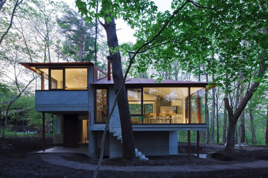 Cell Space Architects designed the Villa-K in Karuizawa, Nagano, Japan.  modern, open, split-level, sloped ceiling, large windows, concrete