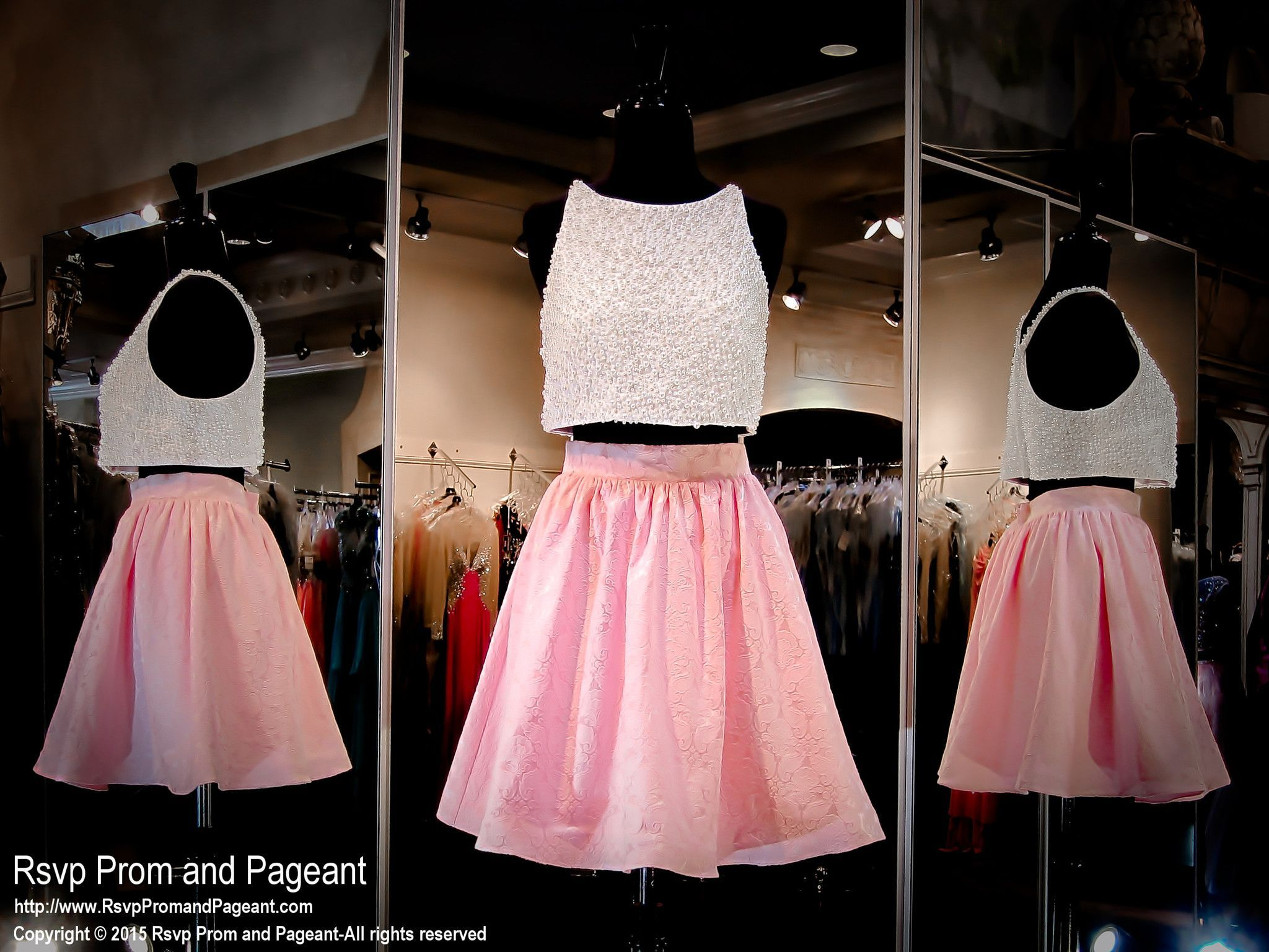 This pretty two-piece short dress has a pink embossed skirt and a ...