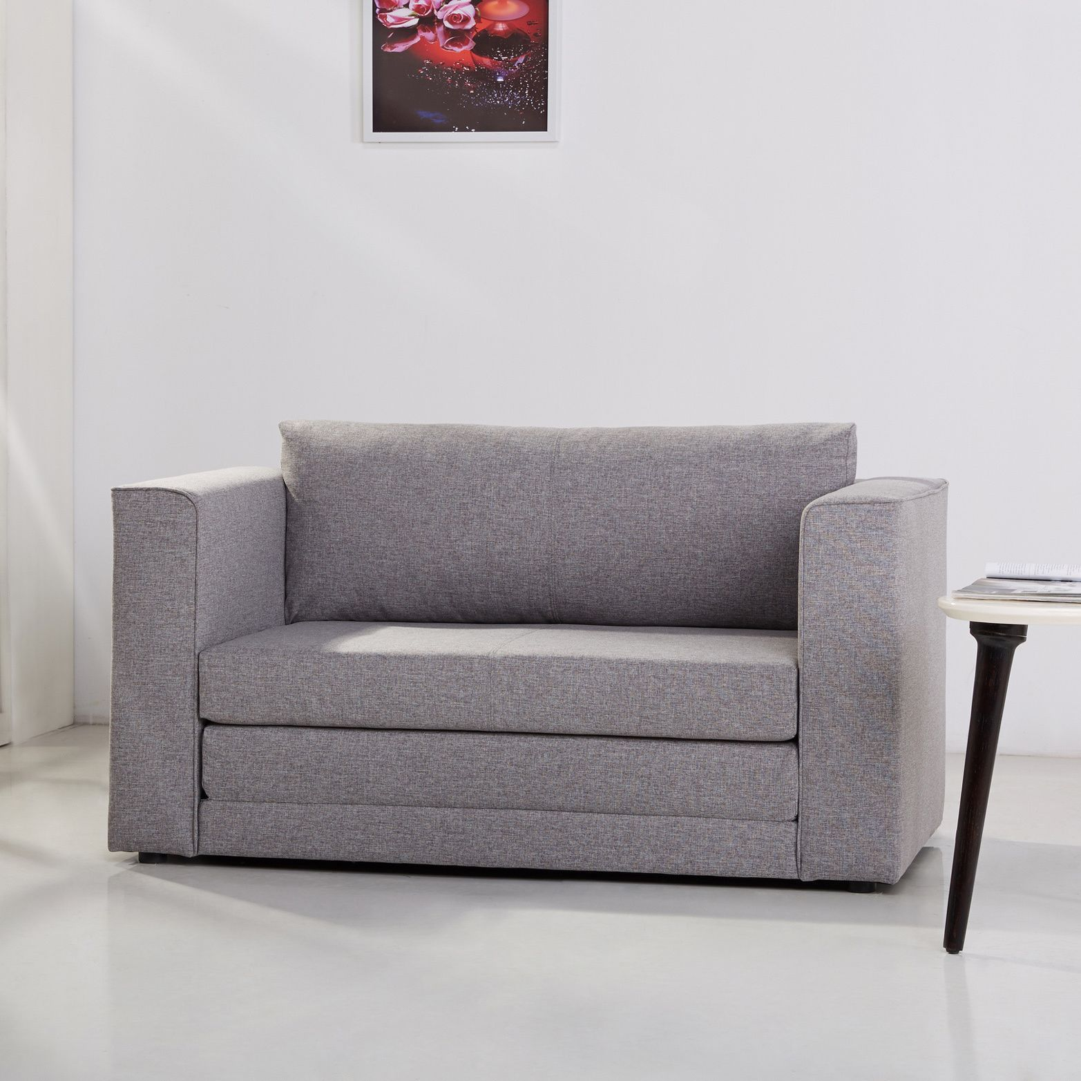 This multi functional contemporary loveseat sleeper adds fort and