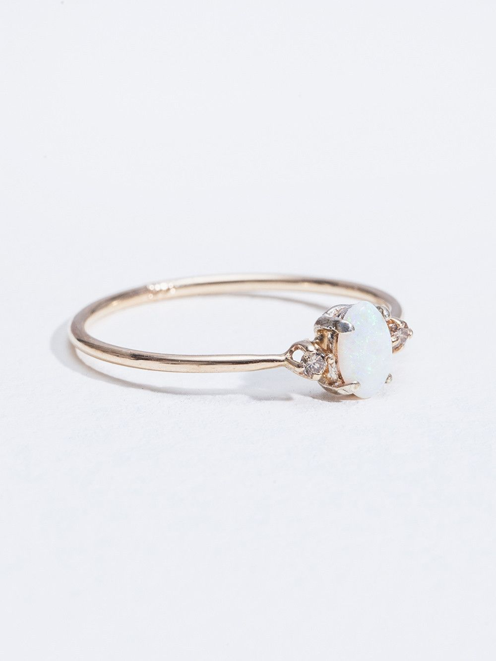"""Theresa M Lee, Opal Ring, Allison, Gold,  This ring is delicate and feminine, the champagne diamonds balance the pure white opal."" (quote) via thedrivenewyork.com"