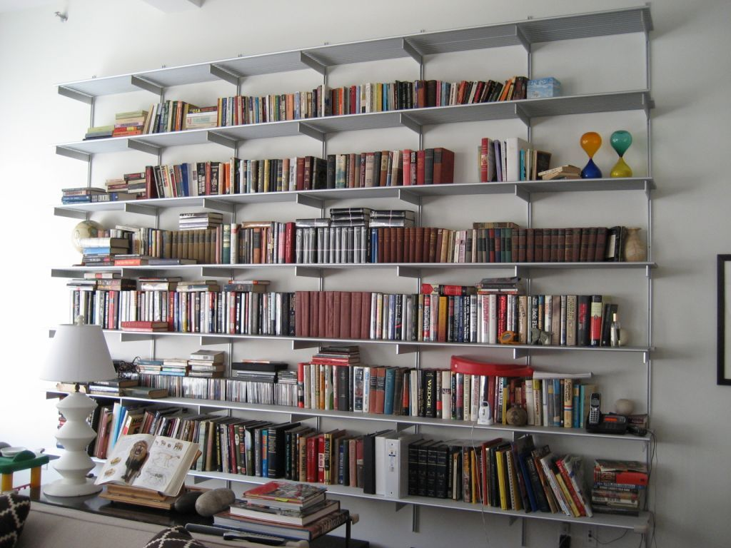 Wall Of Bookshelves http://www.bebarang/creative-wall-mounted-bookshelf-ideas