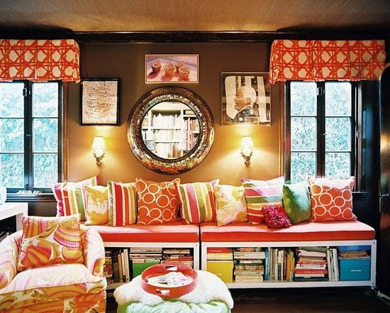 So many fun accent colors and interesting touches- wall art and grasscloth ceilings.