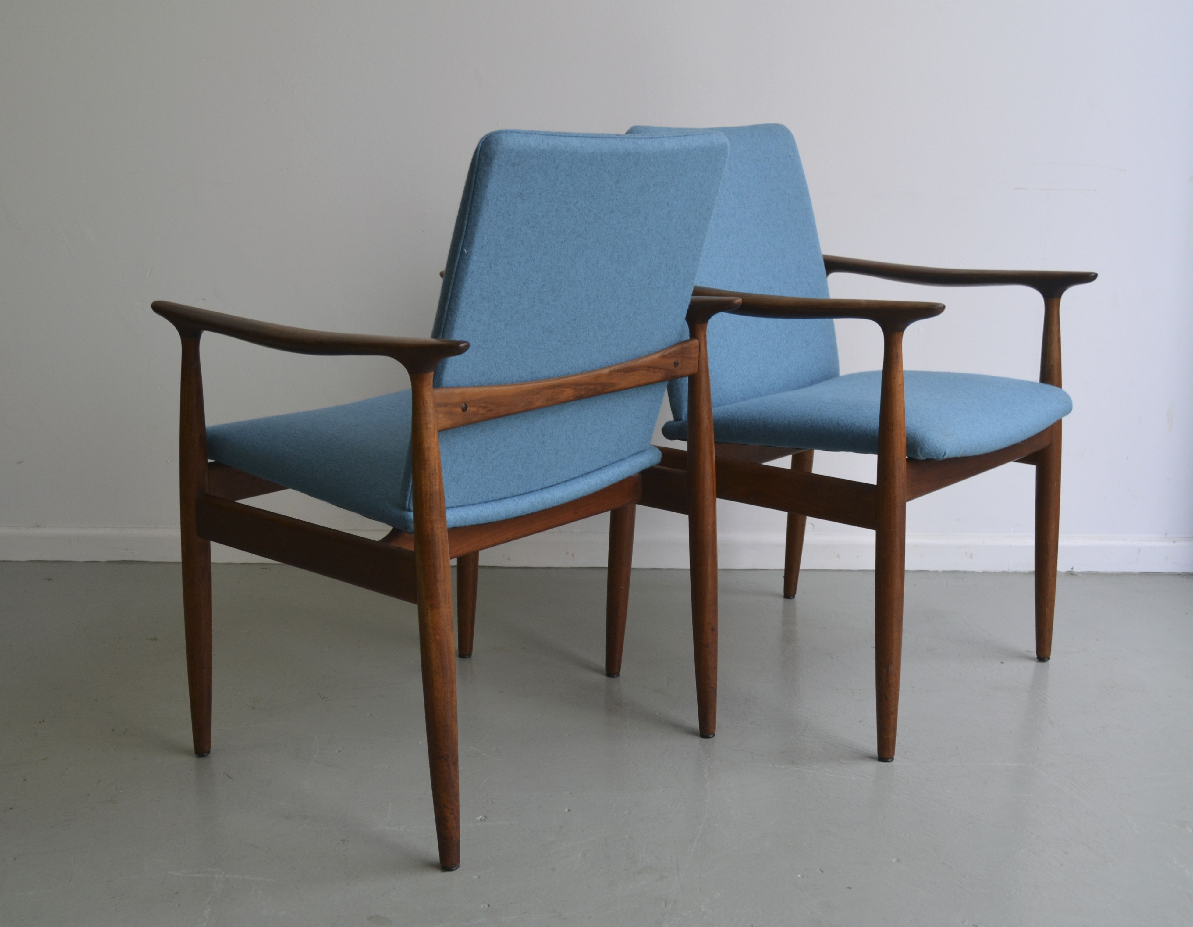 Pair of Parker teak framed armchairs reupholstered in a Danish