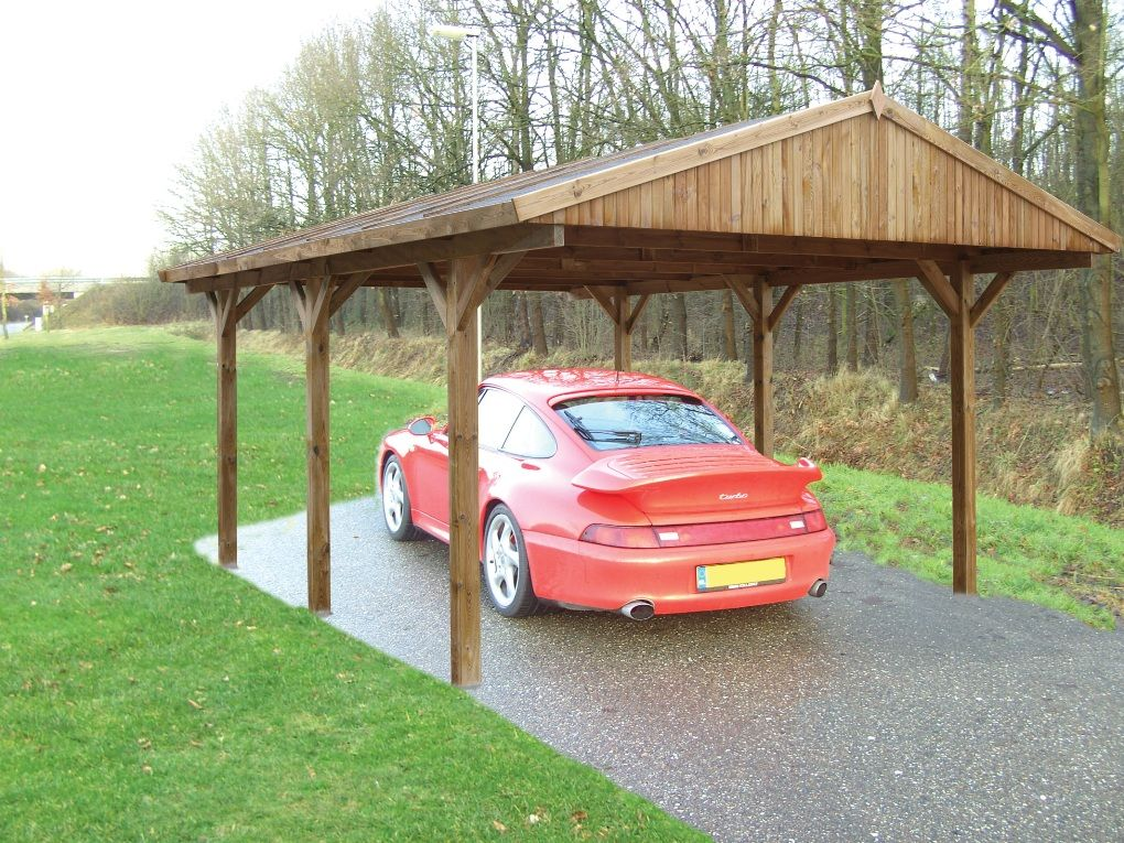 Here is a powder coated grey curved roof canopy being used