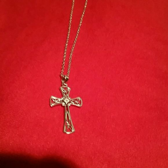 Silver Cross necklace Beautiful silver cross and chain with Diamond chip in the center. Jewelry Necklaces