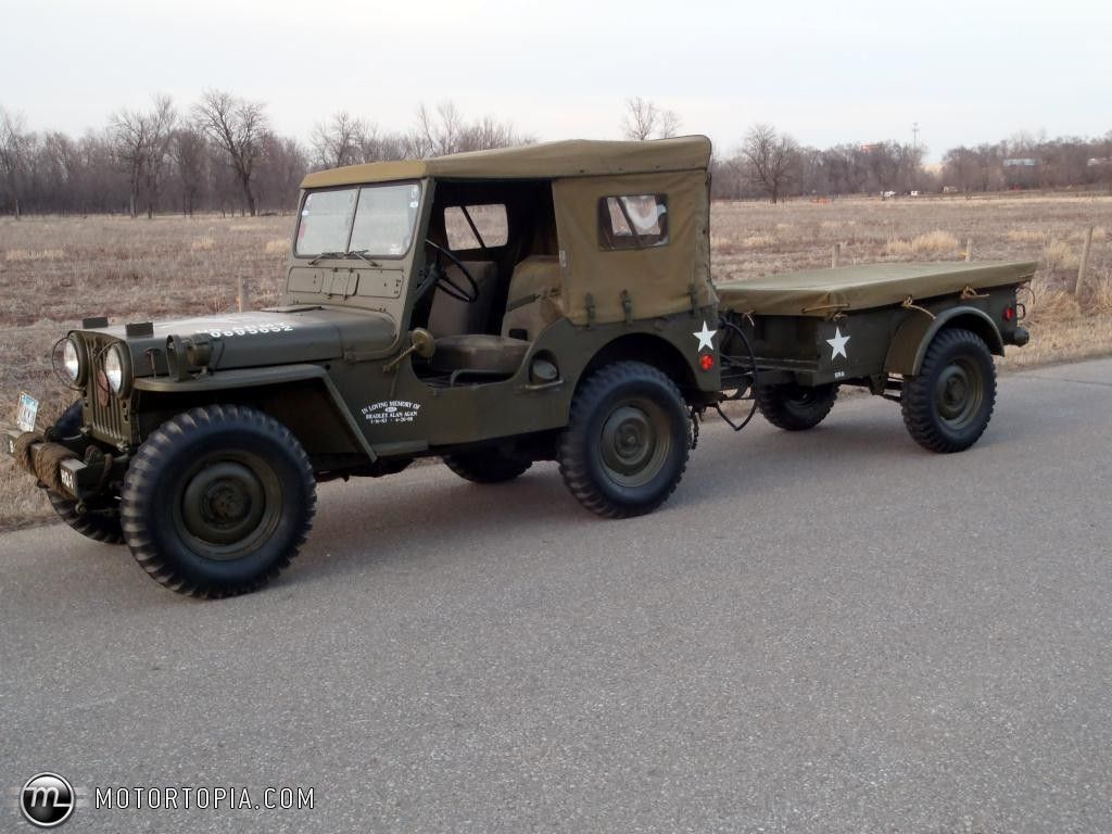 us army 1951 willys mc m38 jeep with canvas top cover on and supply trailer attached to the tow hitch  [ 1024 x 768 Pixel ]