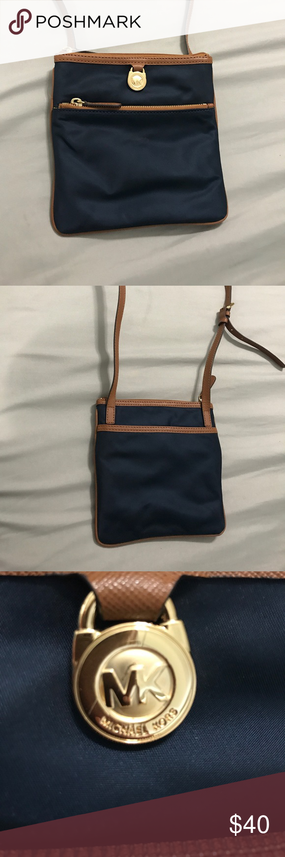 Michael Kors crossbody Michael Kors navy blue crossbody purse. Barely used. No inside stains Michael Kors Bags Crossbody Bags