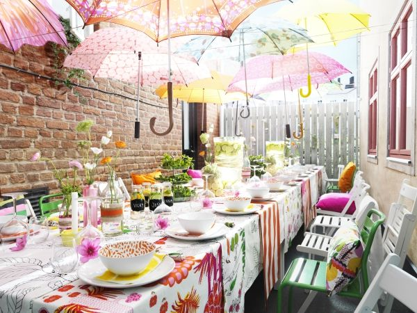 Bring a splash of color to your outdoor dining space with the IKEA ROXÖ outdoor series. Made of steel and coated in a plastic powder, they're durable and easy to maintain. The hanging umbrellas are a fun decor idea, too.
