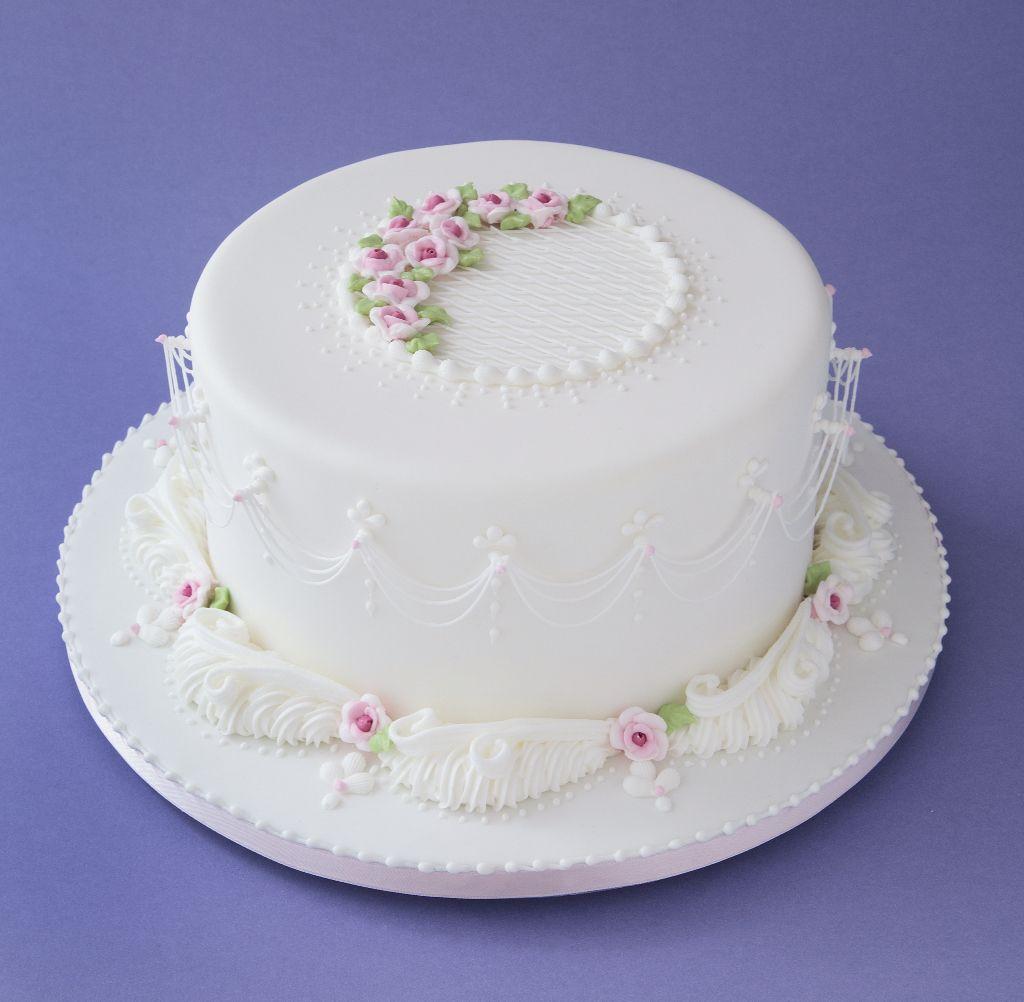 Guirnaldas al aire en glasé real. Cakes royal icing. Rosa María Escribano.