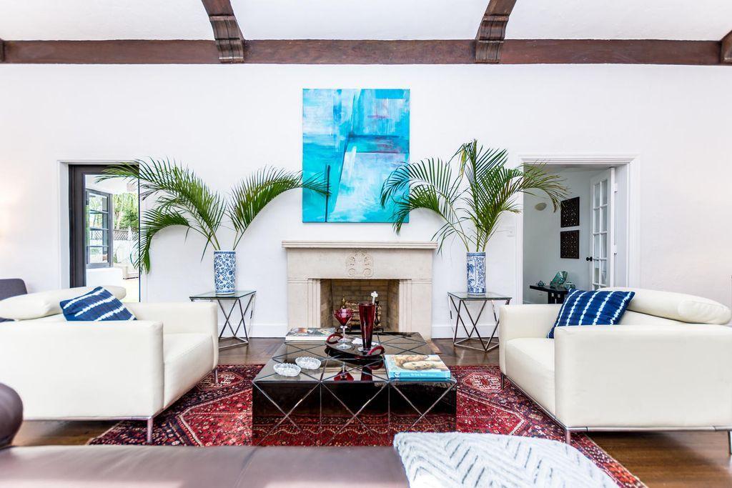 miami home interior design featuring wood beam ceilings fireplace rh pinterest ca