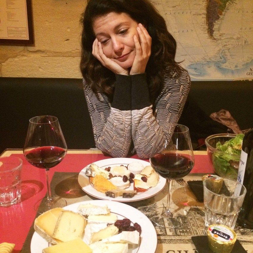 The author blissing out over her all-you-can-eat cheese haul at Baud et Millet in Bordeaux, France. Photo by Christine Cantera.