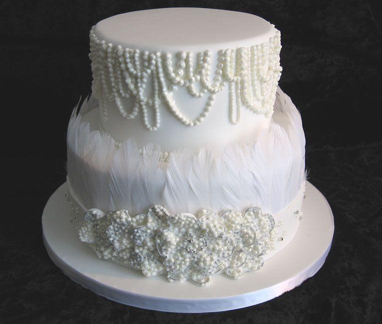 White wedding cake inspired by Spanish dress