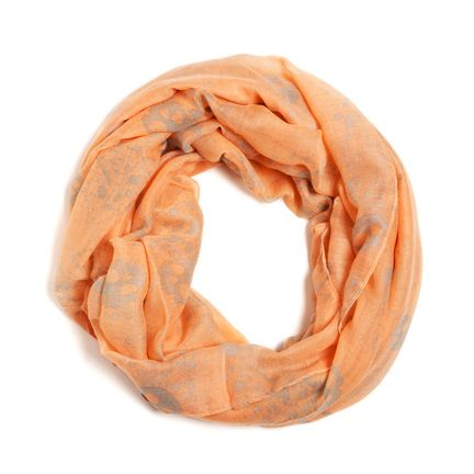 Don't be fooled by Serena's soft tangerine and tan hues; she's got an edgy side to her too! Have fun either way, whether you decide to play up the skulls or the softness of the fabric and hues. This spring/summer scarf is not to be missed. Found it on the bohemian trunk