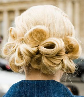 """Makes me miss my long blonde hair. """"Easy. Make 3 even ponytails above nape of neck. Working from outer ponytails in, make loops with small sections of hair; pin in place. Give hair more grip by spritzing with hairspray before looping & pinning."""""""