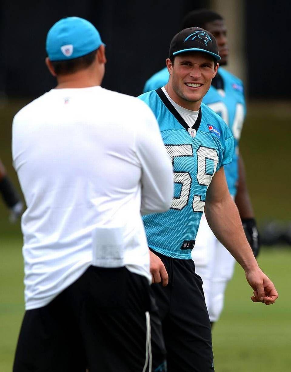 Carolina Panthers linebacker Luke Kuechly, right, talks