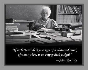 Albert Einstein Laminated Print And Quotation On Cluttered Desk