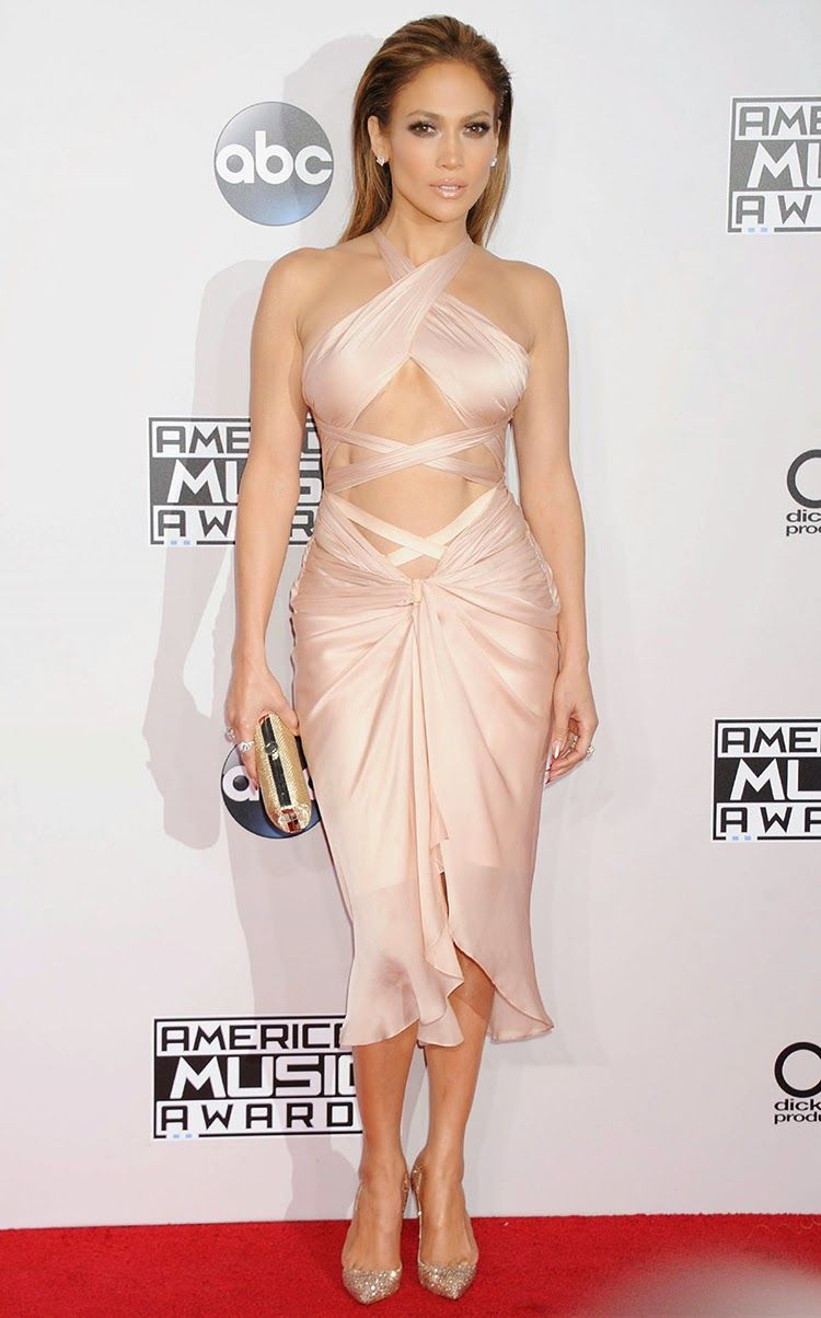 Jennifer Lopez at 2014 American Music Awards in Los Angeles.  Although the blush-pink colour of her Reem Acra Spring 2015 was subtle and sweet, her specific brand of sex appeal was alive and kicking with the ribbons of fabric that wrapped around her torso barely offering more coverage than the runway rendition. That's not to say that the wispy dress didn't look stunning on the entertainer. I even found it somewhat refreshing in comparison to some of her overly glitzy and super-short…