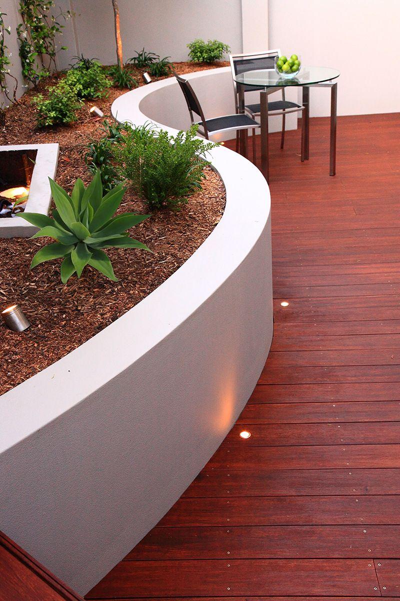 Curved Wall And Decking Landscape Design Poured Concrete Patio Concrete Retaining Walls Concrete Patio