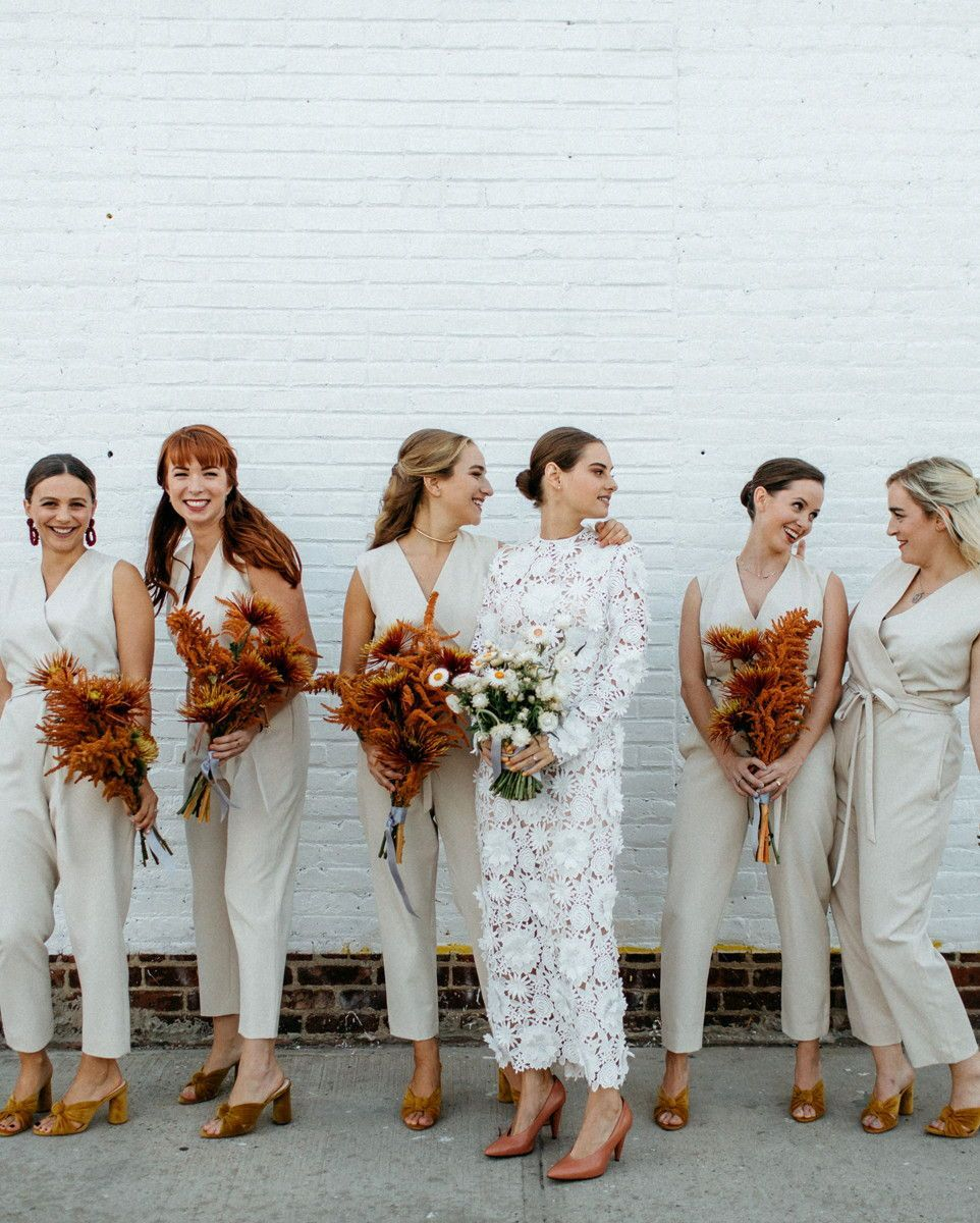 20 Wedding Parties That Prove Bridesmaids' Jumpsuits Are Just as Beautiful as Dresses #bridesmaidjumpsuits The look is fashion-forward, versatile, and flattering—plus, the pants component of these garments allows your crew to move freely on the dance floor. #wedding #bridesmaids #weddingfashion #jumpsuits #weddingparty #weddingideas #weddings #highfashion #weddingtrends | Martha Stewart Weddings - 20 Wedding Parties That Prove Bridesmaids' Jumpsuits Are Just as Beautiful as Dresses #bridesmaidjumpsuits