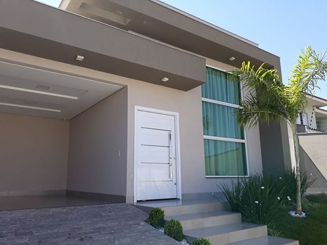 Casa terrea estilo moderno com elementos de destaque para for Portico moderno