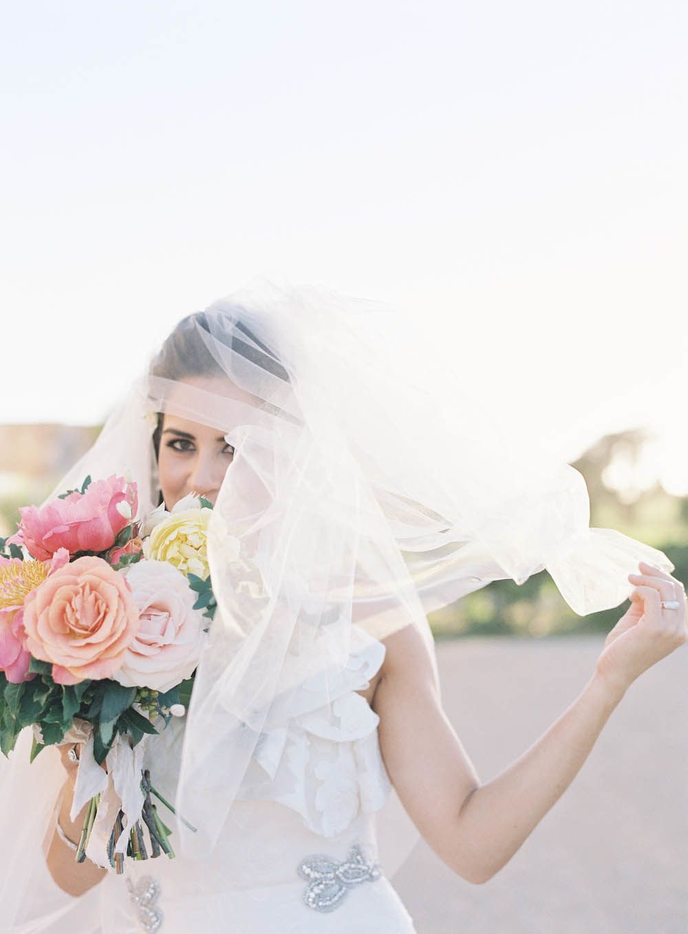 a gorgeous bride with a bit of sass #veil Photography: Jen Huang Photography - jenhuangphotography.com  Read More: http://www.stylemepretty.com/2014/09/08/modern-tuscan-inspired-wedding-with-pops-of-color/