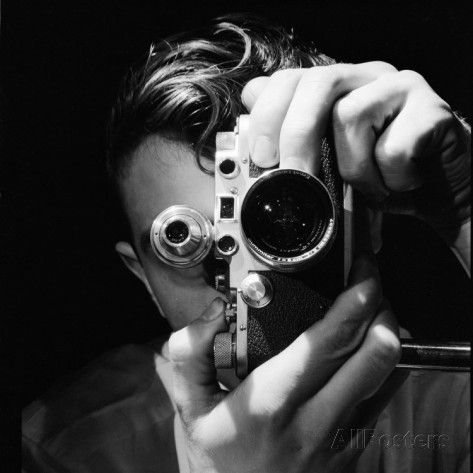 Person Holding Camera To Face Winner Of Life Photo