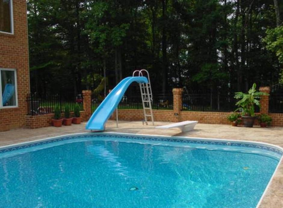 Outdoor pool with slide  The Outdoor Pool Slide   Pool slides, Diving board and Outdoor pool