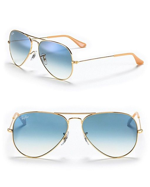 Iconic double bridge aviators are back and look of-the-moment in goldtone metal. Adjustable nose pads for secure comfort. Medium sized lenses. | 100% UV protection | Gold frames with blue gradient len