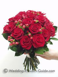 Beautiful Red Passion Roses Red Hypericum Berries And Gerberas