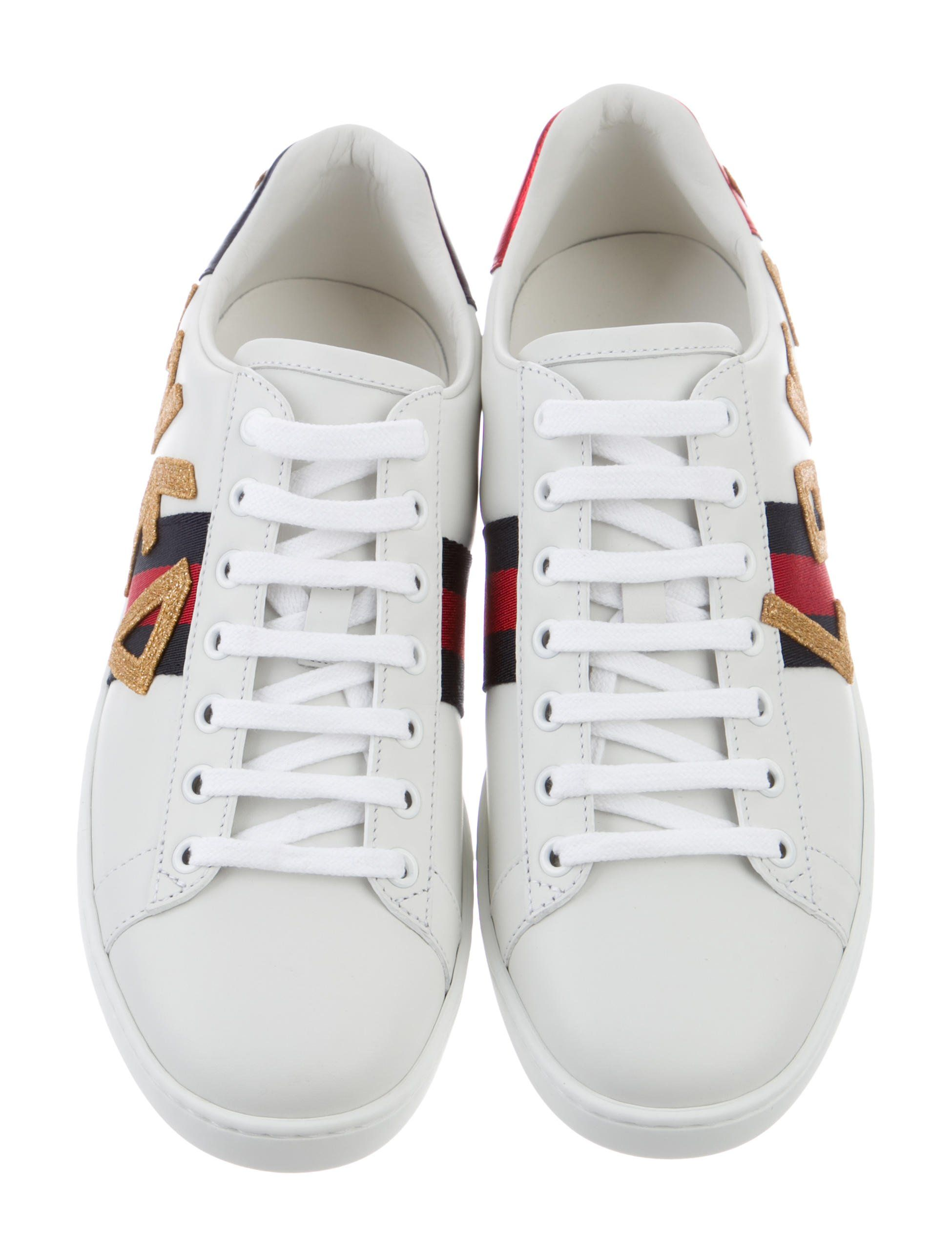 5268787fa18 White and multicolor leather Gucci Ace sneakers with lace-up closures at  vamps