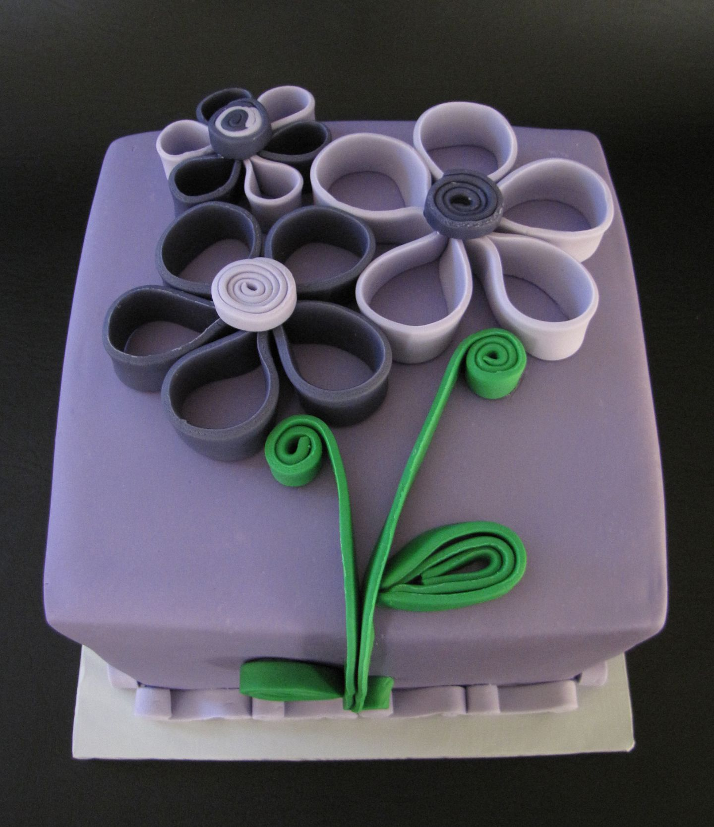 Quilled flowers in purple this is vanilla bean cake with fresh