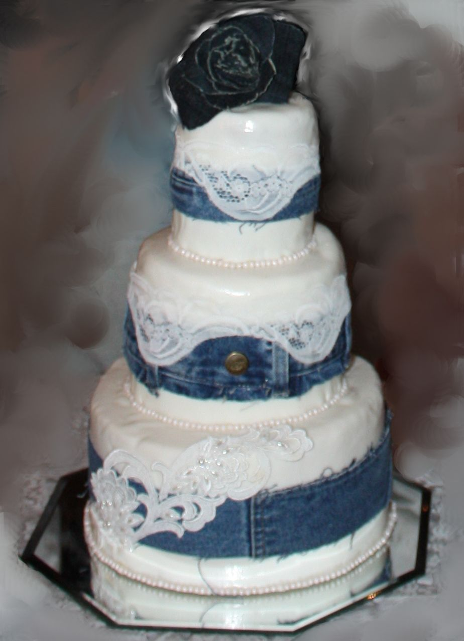 The wedding cake hand-made by my daughter-in-law Rachel: Denim and Lace theme topped with hand-made jeans flower by Cassandra