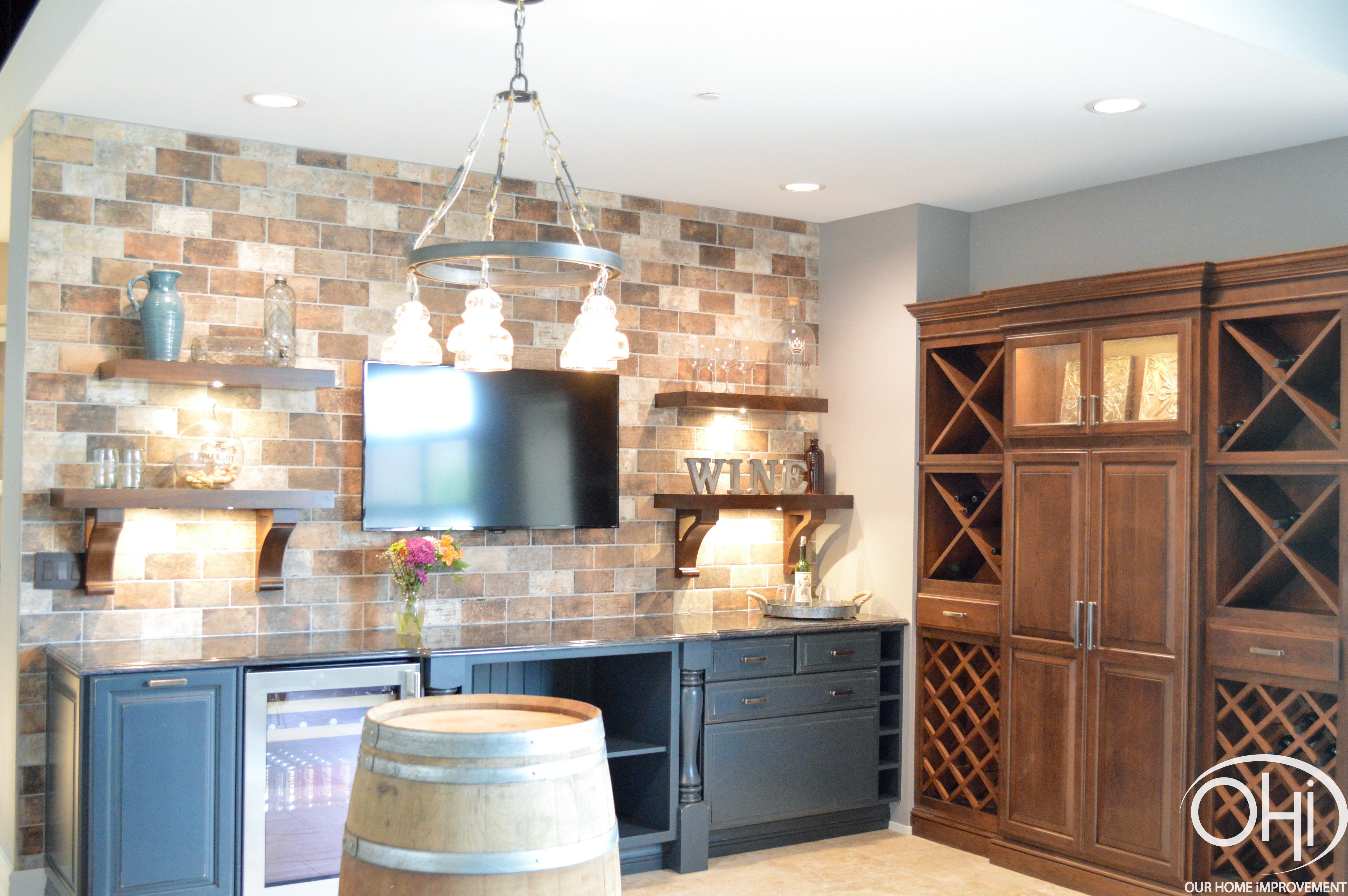 Wine Bar Featuring A Brick Accent Wall Quartz Countertop And Wine Barrel Table Contactohi Winebar Wino Wine Barrel Table Barrel Table Brick Accent Walls