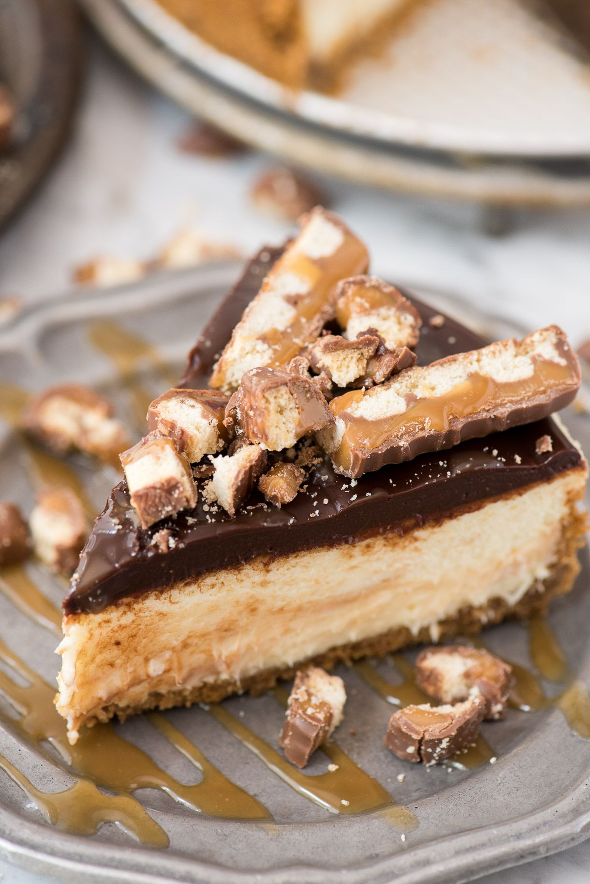 This Twix Cheesecake Has All Your Favorite Twix Flavors The Crunchy Cookie Texture From The Graham Cracker Crust The Caramel From Food Dessert Recipes Cheesecake Recipes