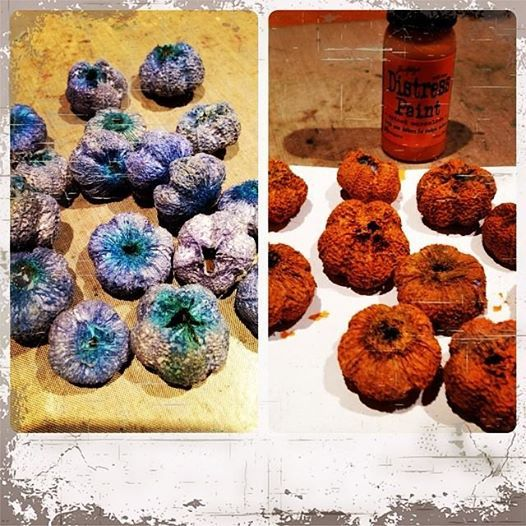 Making pumpkins from spring $1 Store flowers and spiced marmalade distress paint!  Now that's crafty!