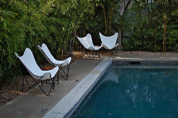 would love some butterfly chairs like this some day, but not white, and in something durable, not canvas.