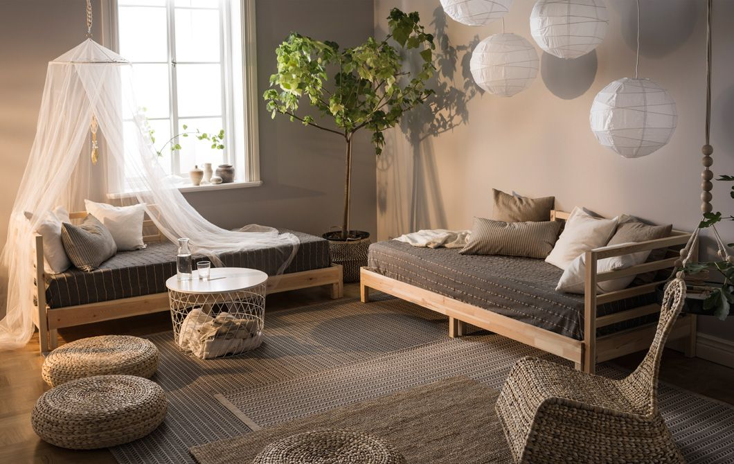 A living room in natural colors and decorated with day beds, paper - wohnzimmer weiße möbel