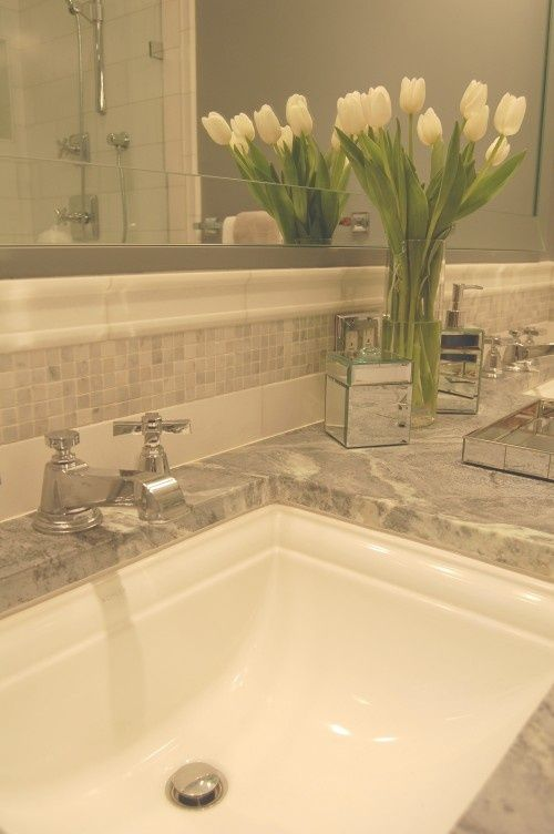 Bathroom backsplash and counters and sink and tulips