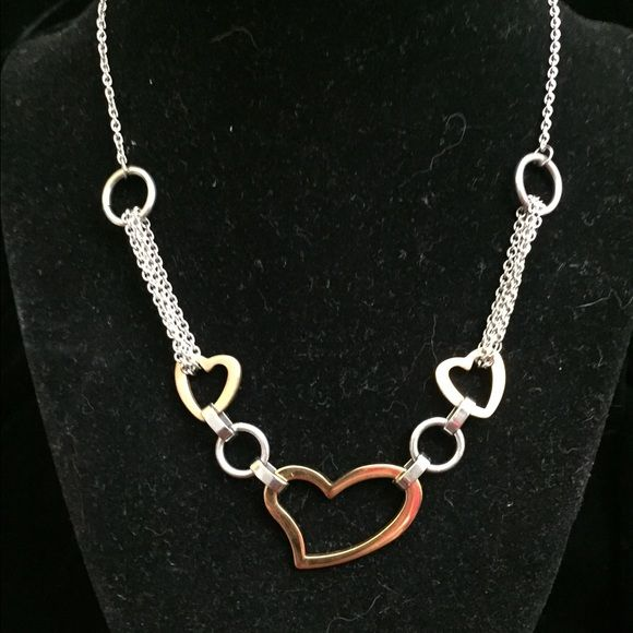 ❤️ Tri-tone Heart Necklace! ❤️ Big gold-tone heart with two small copper-tone hearts on a silver chain! Puts a mix on this bold, striking necklace! 17 inches long. Jewelry Necklaces