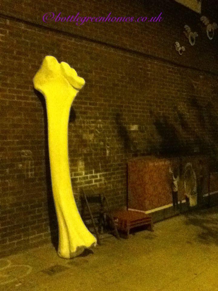 Sculpture bone just off whit cross street.